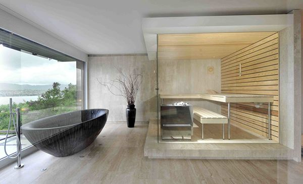bathroom with free-standing tub and sauna.