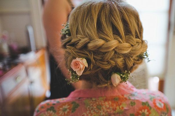 Fresh flowers in the hair, perfect for a garden wedding like ours!