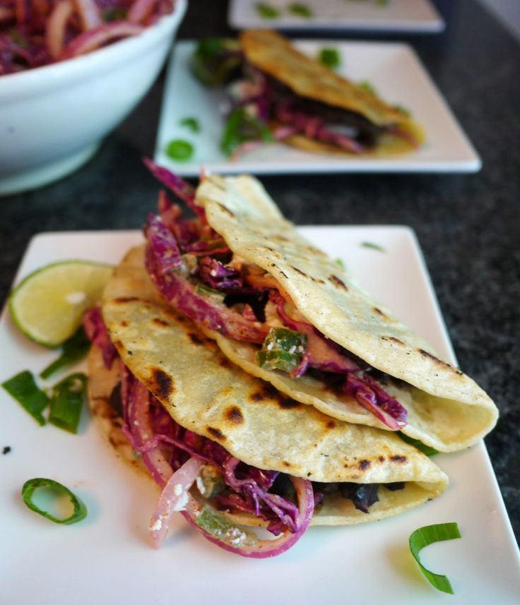 Crispy Black Bean Tacos with Feta and Spicy Lime Cabbage Slaw. The original version on Bon Appetit was a little, well, boring. So I jazzed it up with some spice and herbs. Now, it's amazing!