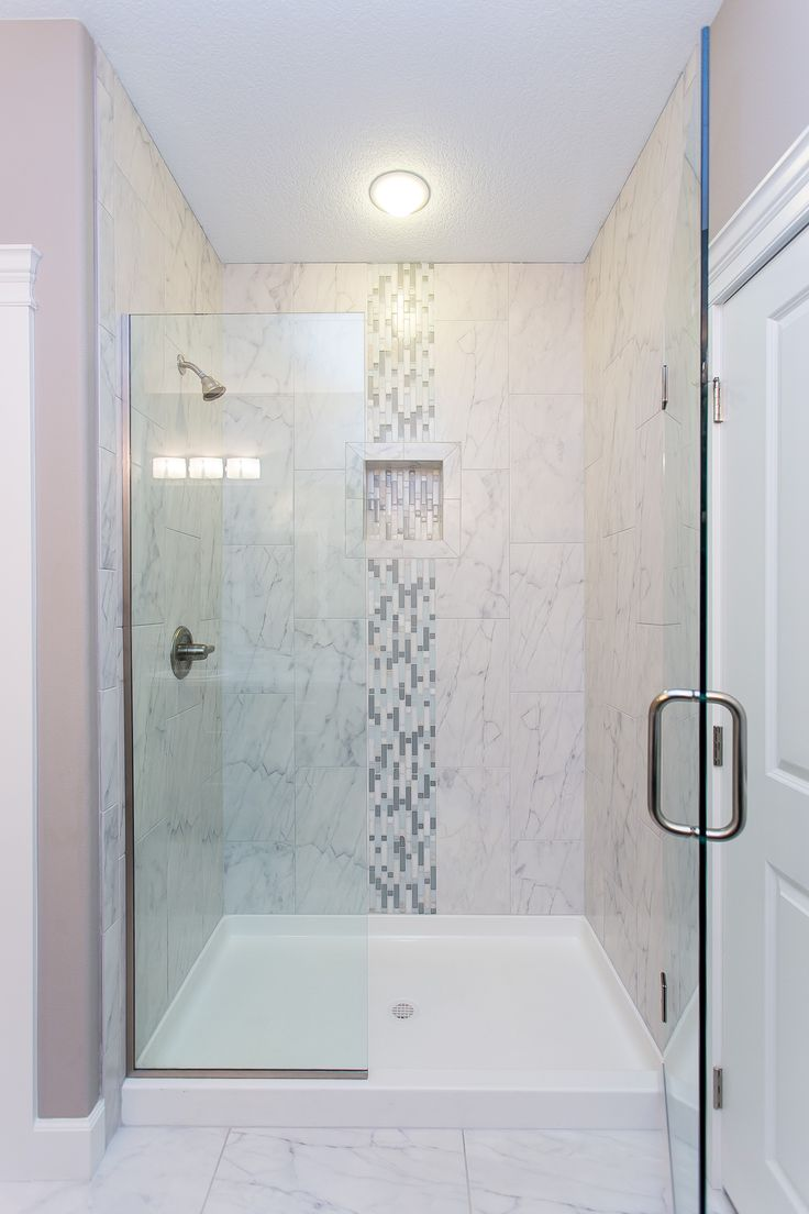 glass accent tiles for bathroom this beautiful tiled shower features modern glass doors 23234