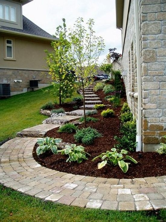 Landscape ideas... love this idea of using bricks as a pathway n border of flower bed!!