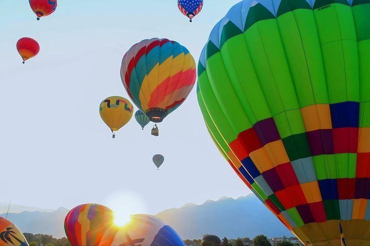 Hot-air ballooning at dawn (adapted from a photograph by M. Nay)