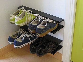 Make your own shoe rack. Bonus- up off the floor and doesn't take up much space!