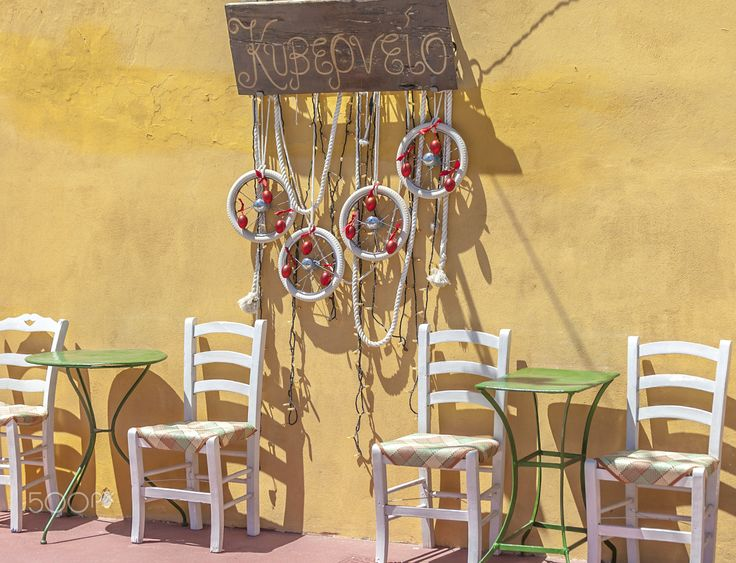 Sit Here - Greek island  lifestyle. Charming small taverna located in Syros Greece.
