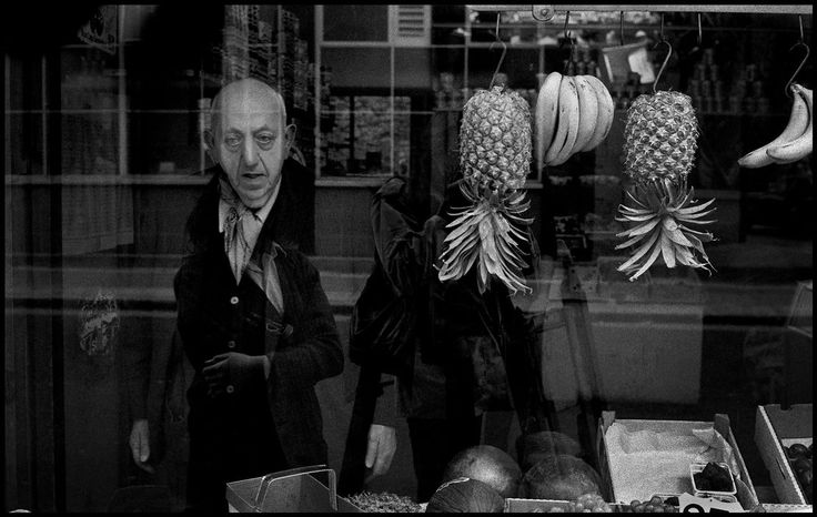 England. London. An elderly grocer gazes out from his vegetable shop window in the Whitechapel district of London. 1972