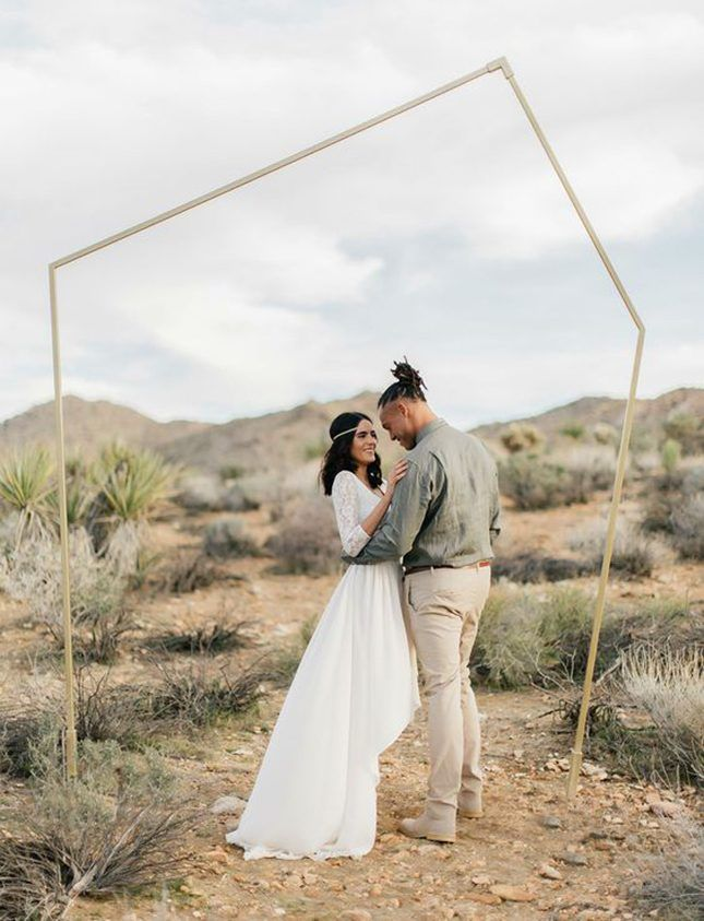 Love the minimalism of this geometric arch for an outdoor desert wedding.