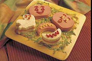 BOOlogna Snackers:  Layer bread, bologna and Singles as desired on cutting board. Cut into decorative shapes using Halloween-shaped cookie cutters or sharp knife.  Decorate with mustard and ketchup.