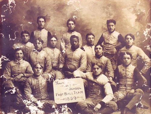 "The FIRST AFRICAN AMERICAN PROFESSIONAL FOOTBALL PLAYER, Charles W. Follis (holding ball), born February 3, 1879, in Cloverdale, Virginia.   He attended Wooster High School and helped establish the first varsity football team, playing right halfback and team captain.  In 1901, he entered the College of Wooster.  Rather than playing football for the college, he played for the town's amateur football team –  where he earned the nickname of the ""BLACK CYCLONE FROM WOOSTER."""