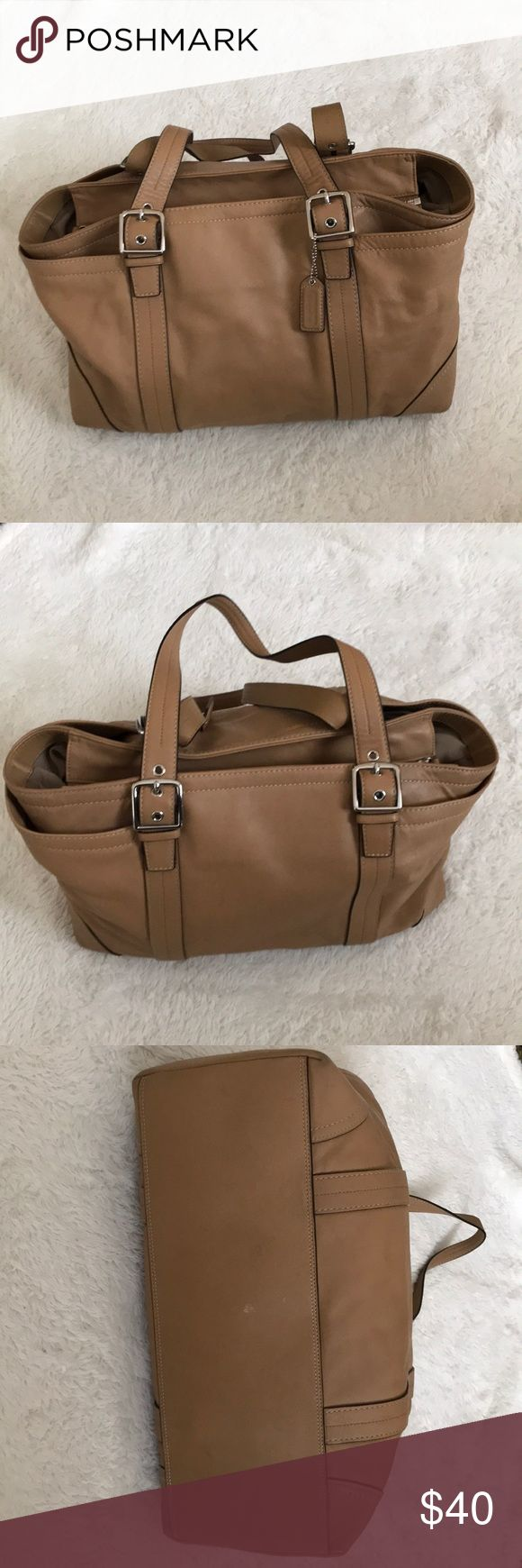 Coach leather bag. Coach leather bag. It's bigger than most medium-sized bags. It has some signs of wear in the bottom. No sling strap to go with it. Zipper opens all the way like a jacket's zipper. Coach Bags Shoulder Bags