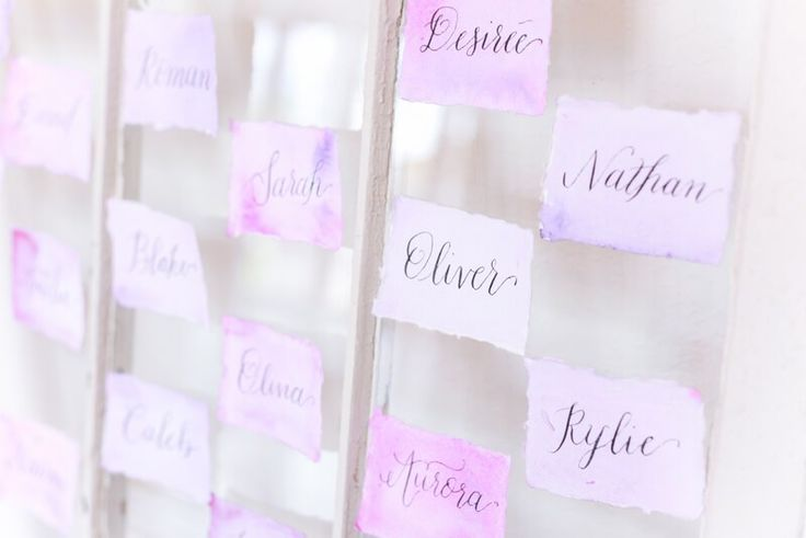 Purple watercolor escort cards from a berry hued wedding inspiration