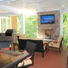 outdoor living space addition with tv mount over fireplace