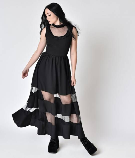 Make a mod move with Bellatrix ladies!  This long black dress is sheer perfection and 1980s goth inspired.  Veering towards the victorian era, the collar of this look has sheer ruffles and a velvet lining.  Following is a sheer layer of dotted fabric surr