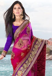 Magenta and red net resham embroidered saree. Contrasting blue art silk blouse is available with this and the blouse shown is only for photography purpose. (Slight variation in color and patch boder is possible).