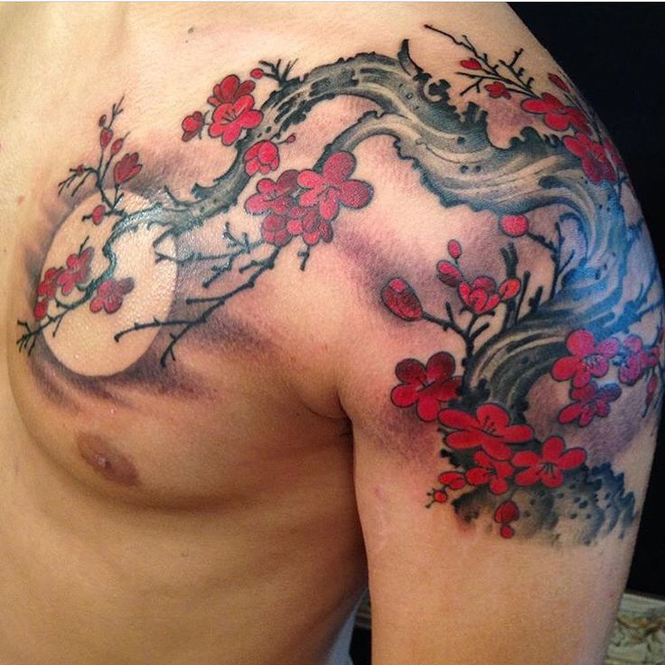 Red blossom tattoo by Kim Saigh at Memoir Tattoo