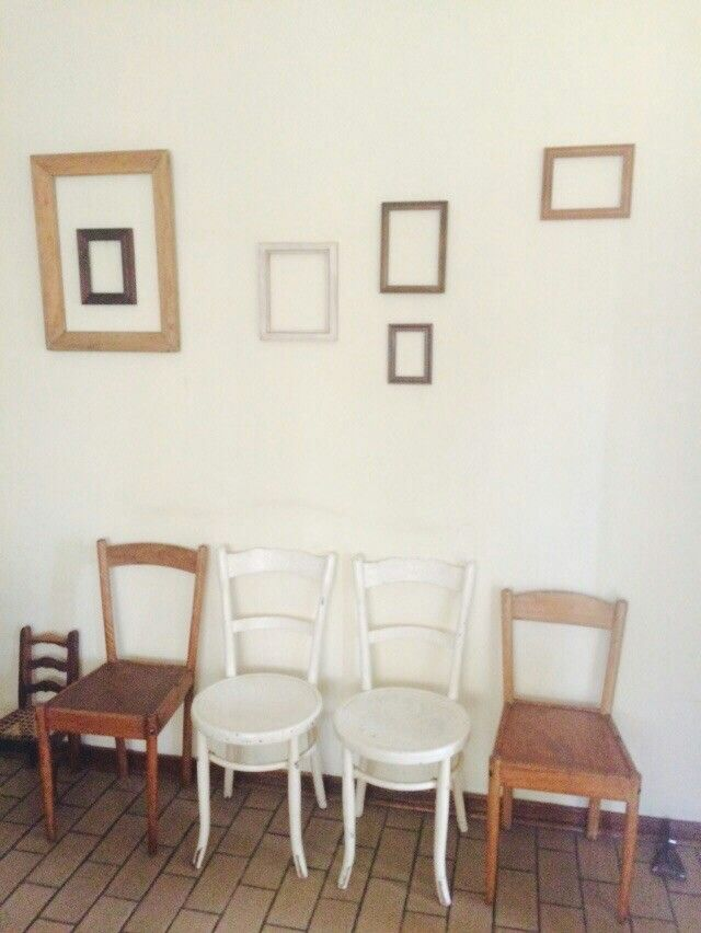 Before I painted my chairs turquoise.... Empty frame wall decor with old vintage chairs