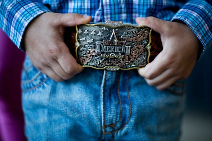 HoustonChronicle.com: Rodeo competitors show their pride with trophy buckles. Treston Brazile, 6, wears a buckle won by his father, Trevor Brazile.