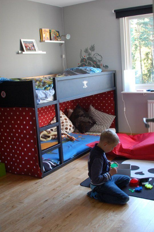Red fabric surrounds three sides of the lower part of this KURA to create a cozy sleeping area. Fröken Bauer. |     20 Ways to Customize the IKEA KURA Loft Bed & Make It Your Own