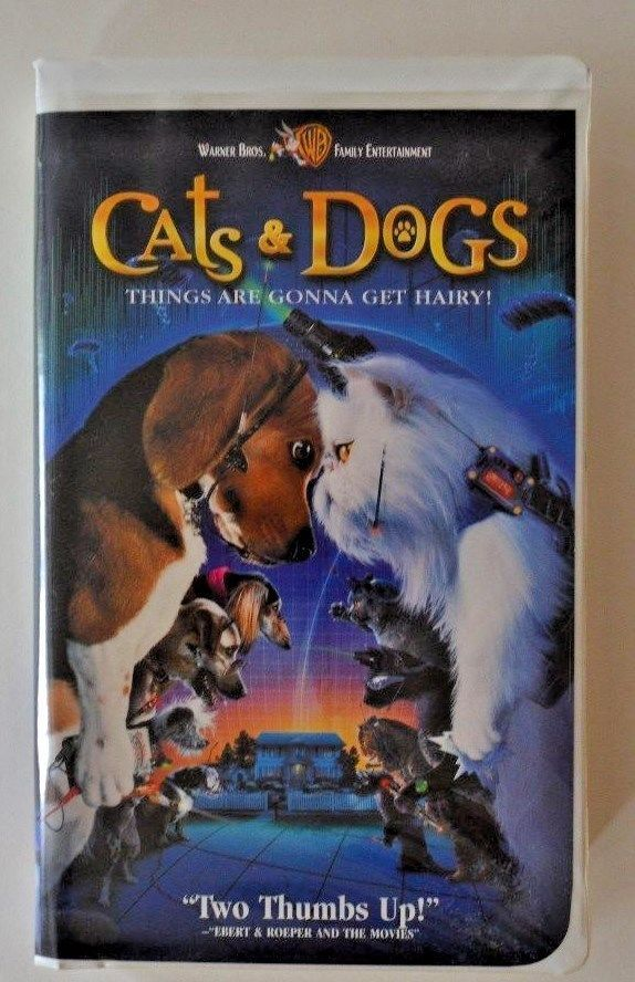 Cats And Dogs Vhs Movie 2001 Clamshell Warner Bros Pg Movie Vhs Movie Dog Cat Dog Movies