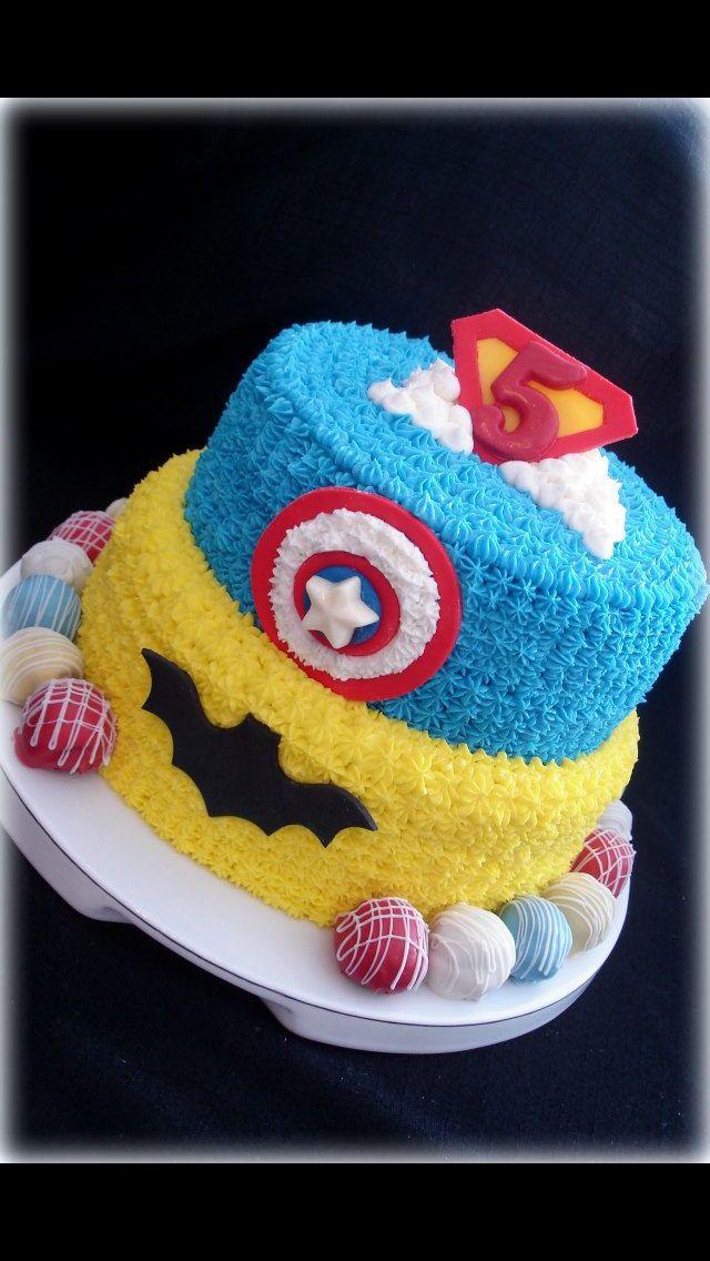 Superhero theme cake buttercream icing fondant decor truffles along bottom Sugar Tummies Sweets & Treats