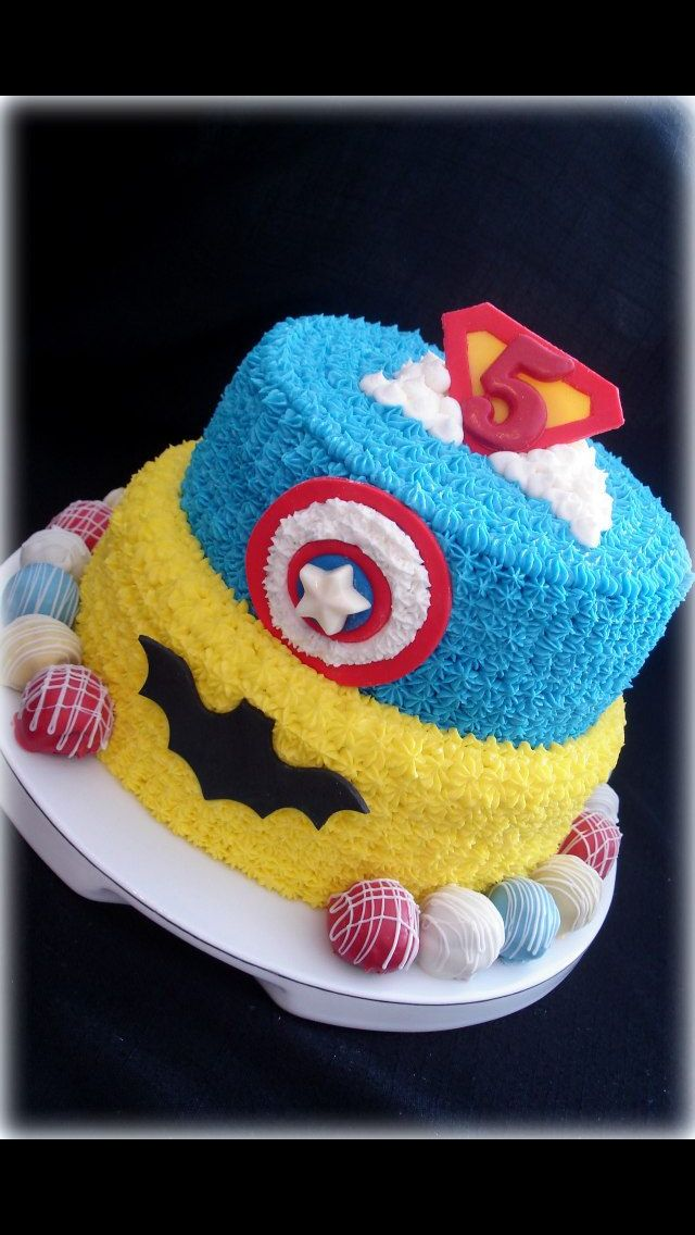Superhero theme cake buttercream icing fondant decor truffles along bottom Sugar Tummies Sweets & Treats