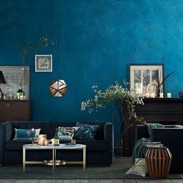 Idee Indoor Wohnzimmer Wand Blau Farbe Sofakissen Leuchte