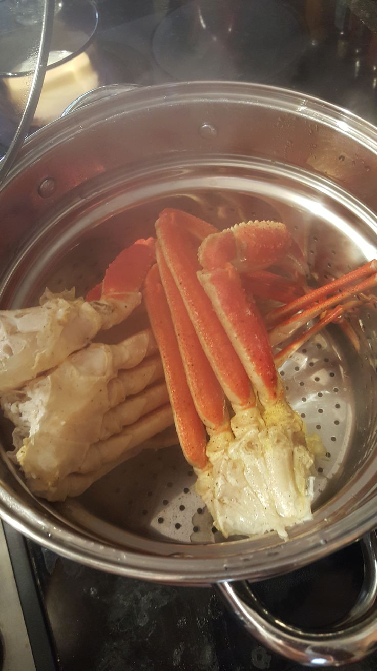 Steamed Snow Crab Legs Seasoned with Adobo and served with melted butter.