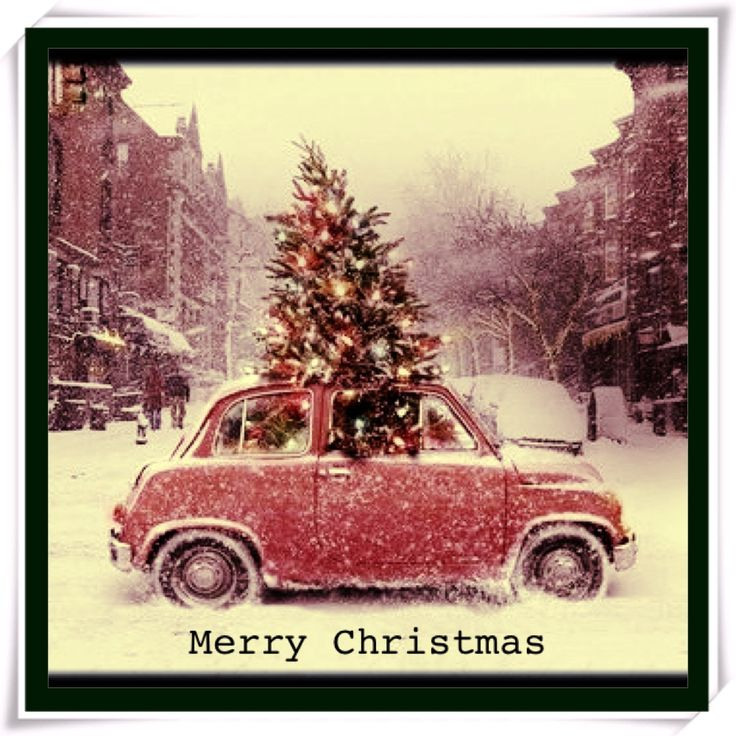 Christmas Tree With Lights On In An Old Red Car And White Snow