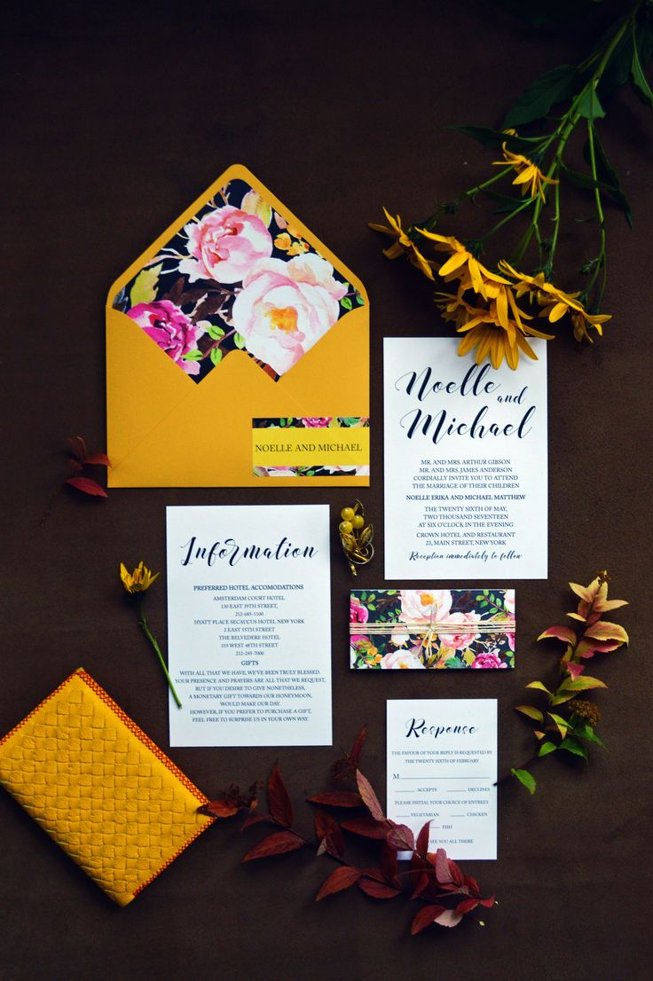 Gorgeous mustard wedding invitation and floral lined envelopes