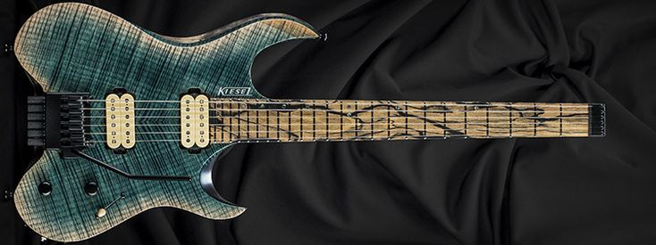 Kiesel Guitars V6X, arctic (50), antique ash treatment (AAT), deep clear flame (FDC), clear satin finish (CS), rear natural clear finish (RNC), swamp ash body (ASH), 3 piece body (3PB), pale moon ebony fingerboard (50), offset dot inlays (IOD), abalone inlays (IA), 14