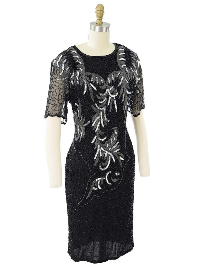 Glam 80s black beaded cocktail dress with silver sequin design. Sexy cutout back. With the right accessories will make a great flapper style outfit.
