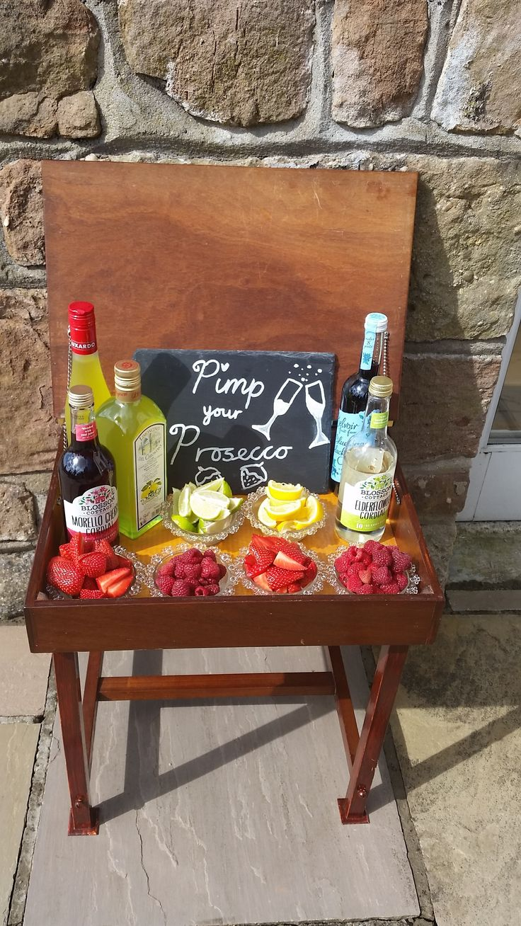 Pimp Your Prosecco. Wedding entertainment. Drinks reception. Upcycled old school desk, cordials & fruit.