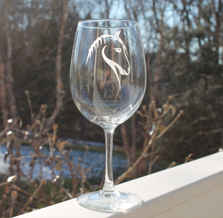 Custom etched horse wine glass. All of our glassware is sandblasted and handmade by us in our studio. Sandblasting is a technique used to engrave on many different surfaces such as stone, glass, wood, and metal. We do not use any chemicals to etch our glassware.