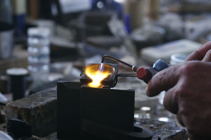 Gold pour at John Miller Design. Molten gold is poured into the heated ingot mold then we begin to create something special