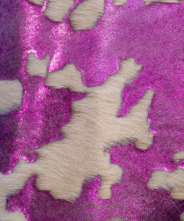 Materials manipulation for a glamorous camouflage effect (metallic glittered leather and poney hair parts).