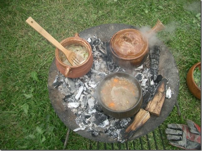 from Viking Food Guy — Recreating the food and drink of the Viking Age (and others): Leeks and dried fish simmering in cream in the upper right and a barley pilaf with carrots and onions in the lower left.