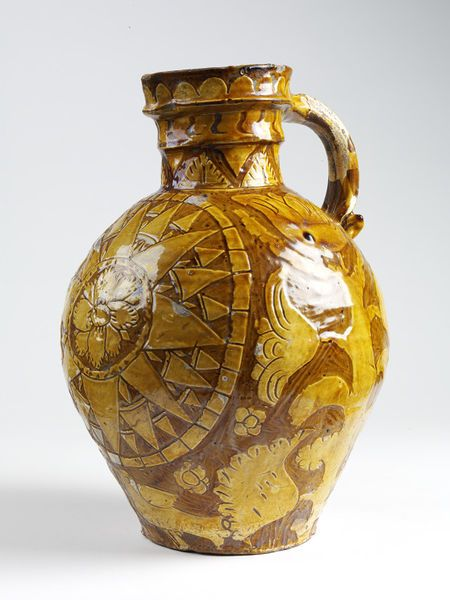 """1764 British Jug at the Victoria and Albert Museum, London - From the curators' comments: """"Big harvest jugs were a speciality of the potteries in the Barnstaple-Bideford area in north Devon. Traditionally, cider was brought out to thirsty harvesters in the fields. A compass design was often incised through the white clay slip of these jugs. This reflects the maritime importance of these West Country towns."""""""