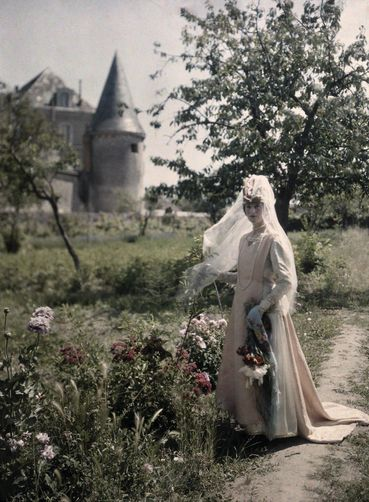 Tours, Centre Region, France. A woman stands in the gardens of 13th-century Marmoutier Abbey. Photographer: JULES GERVAIS COURTELLEMONT
