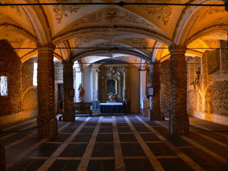Nsandre/Wikimedia Commons/Bone Chapel - chapel in Evora Portugal in which the walls and features are made of humn skulls and bones/Capela dos Ossos -Évora