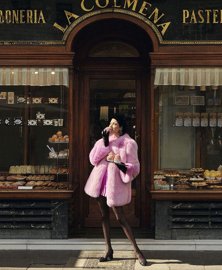 Posing outside of a pastry shop, Hanaa Ben Abdesslem wears pink Gucci fur coat