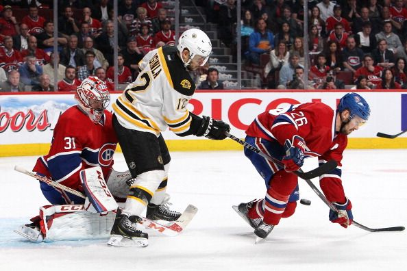 Jarome Iginla #12 of the Boston Bruins looks for a deflection as an inbound shot is blocked by Josh Gorges #26 of the Montreal Canadiens while Canadiens goalie Carey Price #31 guards the net in Game Six of the Second Round of the 2014 NHL Stanley Cup Playoffs at the Bell Centre on May 12, 2014 in Montreal, Quebec, Canada.