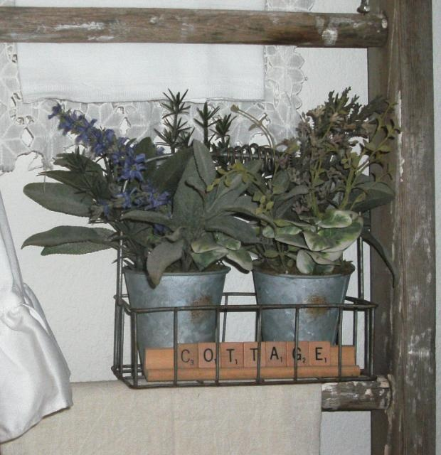 Love this little herb display cottage style basket out of an old milk bottle carrier - perfect touch with the scrabble letters!