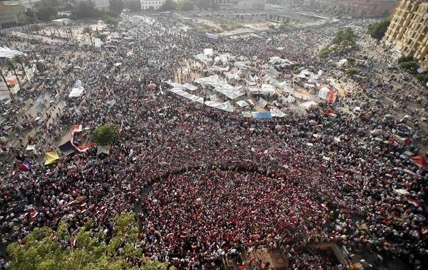 To protect women in Cairo's Tahrir Square from sexual harassment and assault, Egyptian men have begun forming human shields around the female protesters. (Suhaib Salem via buzzfeed.com)