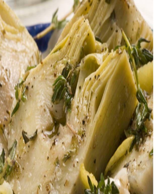 http://www.elle.fr/Elle-a-Table/Recettes-de-cuisine/Petits-artichauts-violets-a-l-italienne-2077962      8 artichauts violets prince de bretagne 50 g de parmesan râpé 20 g de beurre 10 cl d'huile 10 cl d'eau       2 gousses d'ail 10 brins de persil plat 2 cuillère(s) à soupe de chapelure le jus d'un citron sel et poivre