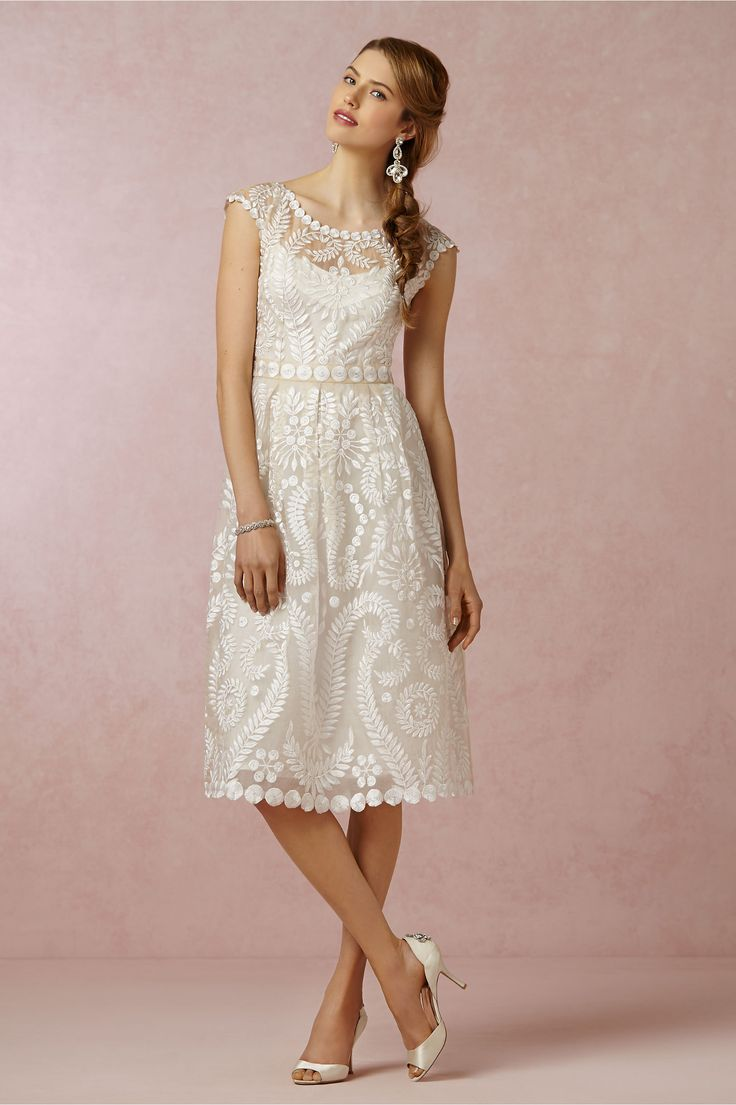 Hanna Dress from BHLDN. Richly detailed embroidery decorates every bit of Yoana Baraschi's chic fit-and-flare, from the tailored bodice and cap sleeves, down to the tips of the scallop-edged skirt.