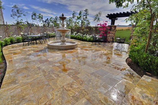 This Impressive Concrete Patio Features Intricate Stamped And Stained Applications