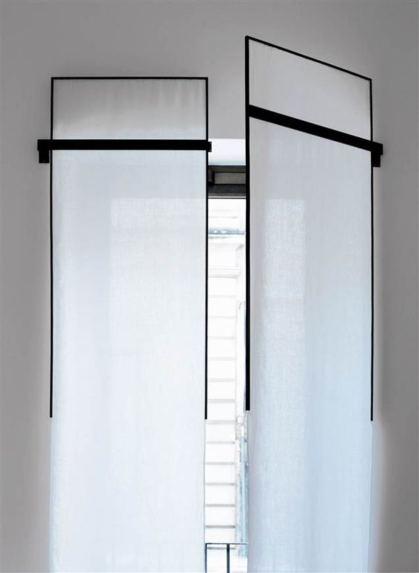 Designed by Antonio Citterio Patricia Viel Interiors, these uber contemporary window treatments, composed of simple sheaths of fabric set into hinged metal frames, are designed to open and close like shutters. The ultimate in clean lined beauty.