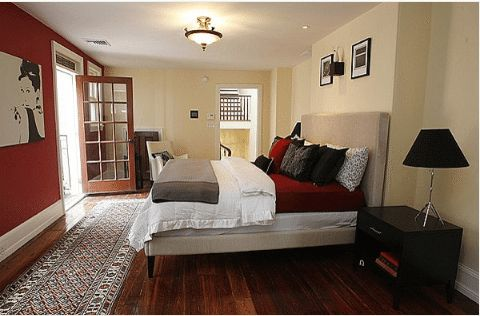 Red, White, and Black Bedroom designed by Busybee Design.