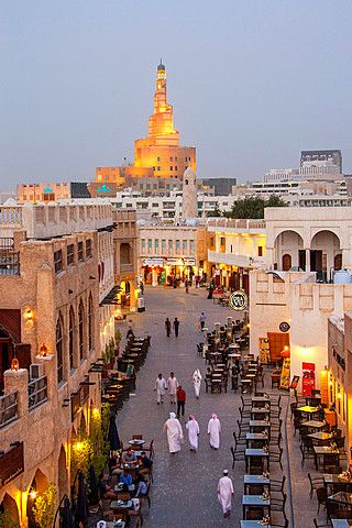 Qatar, Doha City, Souk Wakif and Islamic Culture Center at night.