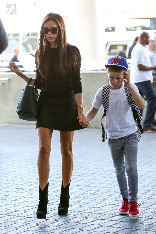 Victoria and David Beckham jet out of L.A. with their Kids
