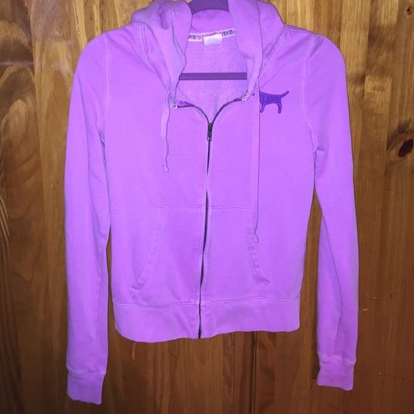 Victoria secret PINK zip up A purple zip up hoodie with decal on the back. There are no rips or tears and the zipper works. PINK Victoria's Secret Jackets & Coats